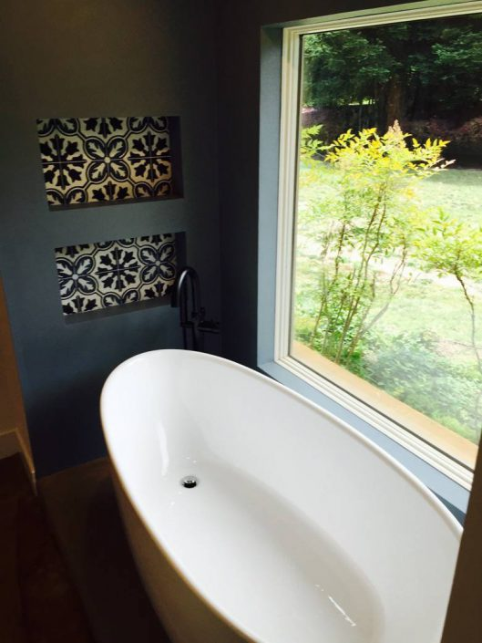 Singer General Contractor: Custom bath. Waterproof plaster and custom hand made cement tiles.