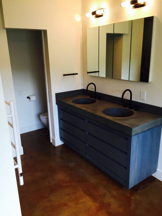 Singer General Contractor: Custom bath. Custom cabinetry and concrete countertop.
