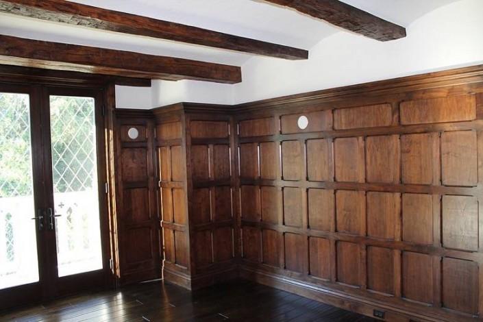 Meschi Construction Inc.: wood paneling, french doors