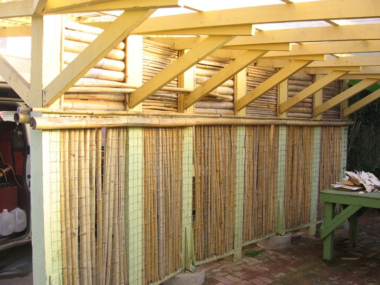 Ray Newkirk Outside the Box Builders: Bamboo, redwood & corrugated fiberglass 2-car center wall carport