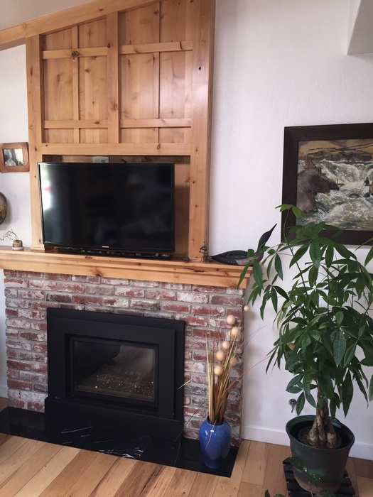 Champlin Interiors: Craftsman Style fireplace in knotty alder