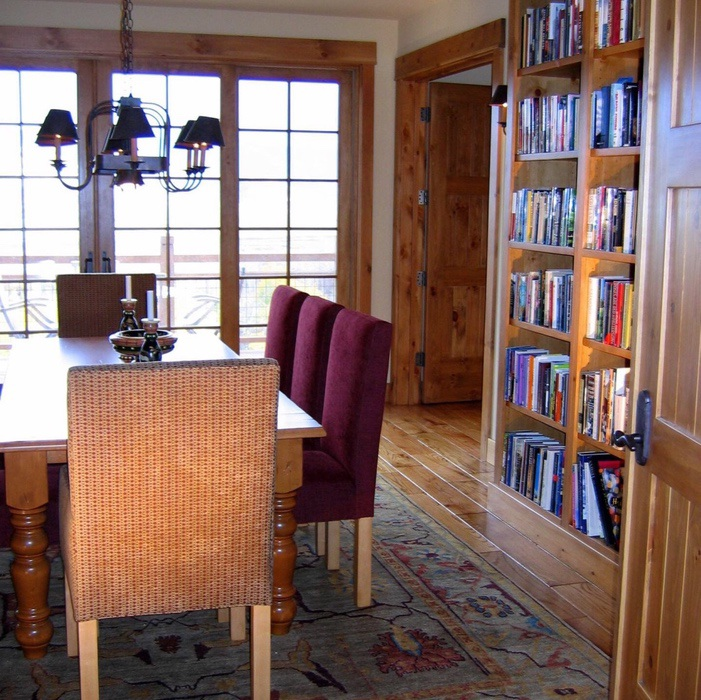 Champlin Interiors: Dining room for an avid book lover