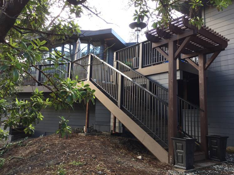 Ray Newkirk Outside The Box Builders: Becker remodel by OTB Builders & Mike Hartrich Design Build with new composite deck & stairs, modular steel railing, inset riser lights in stairs, Hardie plank siding, trellises, window wall & more. Scotts Valley