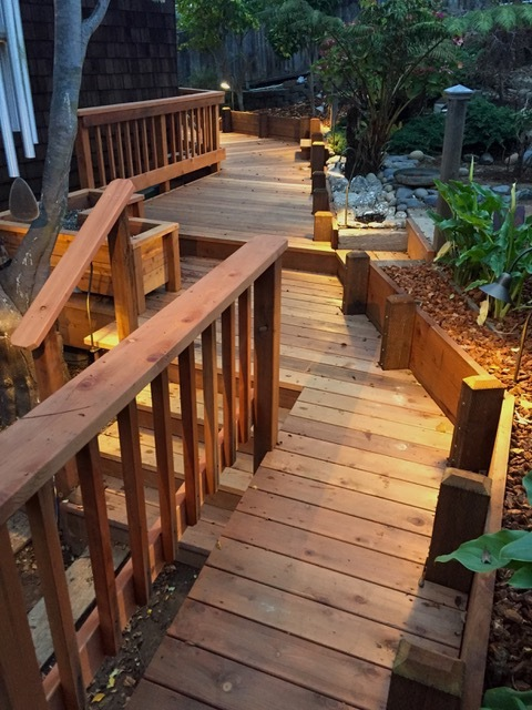 Outside The Box Builders - EATON/KAYE deck, retaining walls, stairs, railings at night with low voltage LED lighting. Rio Del Mar