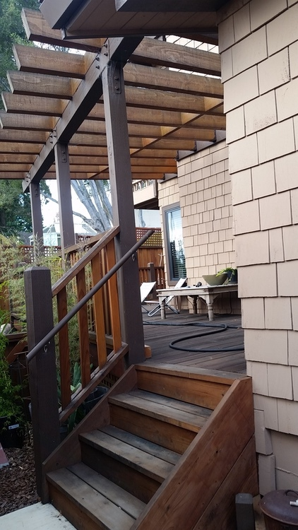Outside The Box Builders - Kathleen & Jim's: Another custom trellis behind house sloped down from house & angled away horizontally for extra building fun! So it slopes in 2 directions but rafters are all flat to each other. how do they do it?!?