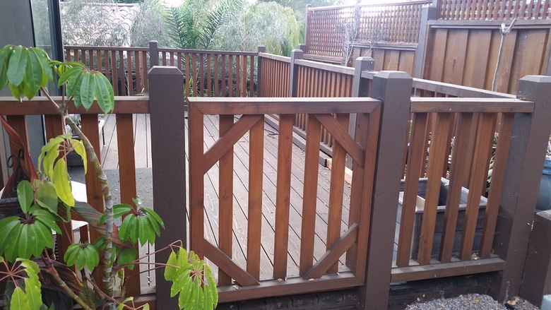 Outside The Box Builders - Kathleen & Jim's: Custom gate & railings. All hardware on project is stainless steel to last forever. Custom milled balusters set in grooves in top & bottom rails, blocked between with invisible drainage holes below. Not your typical railings.