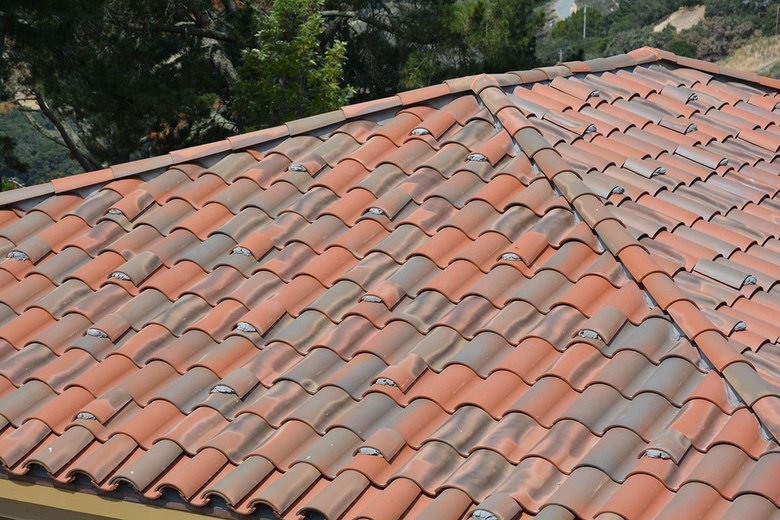 Premo Roofing: clay S tile with mortar birdstop and feaux field boosters