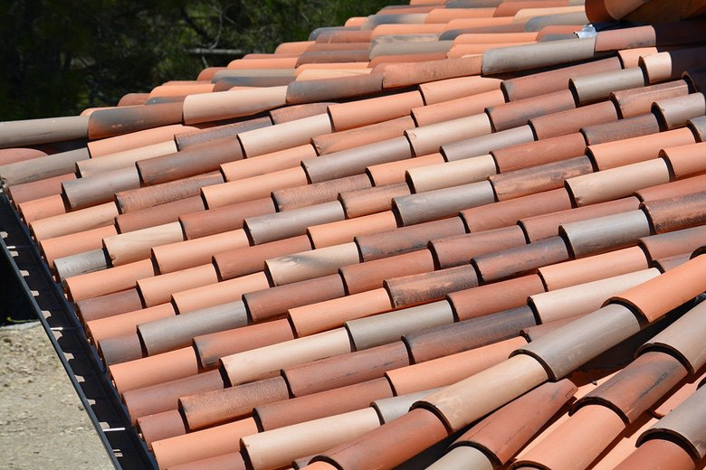 Premo Roofing: staggered application of Redlands two piece mission tile detail