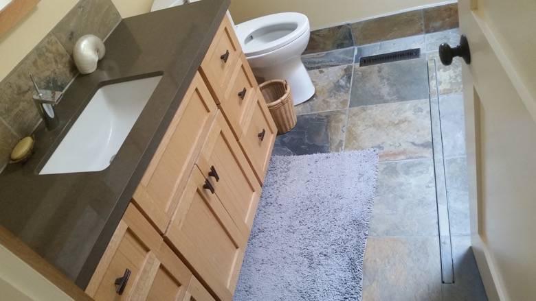 "Ray Newkirk Outside The Box Builders: Herbert custom bathroom with hand built oak vanity, Caesar Stone counter, slate backsplash, floor & base""boards"" & stainless steel trench floor drain"
